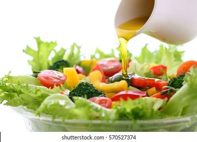 Put a dressing on vegetable salad