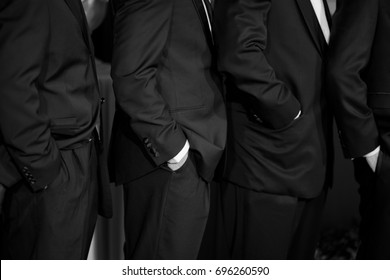 put hand in suit pocket