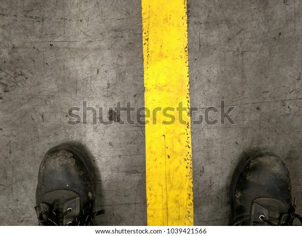Put on shoes standing between the yellow lines.