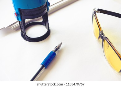 put print on the print in the office on a table with white paper, glasses and a pen on a white background