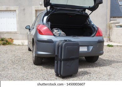 To put the suitcase in the boot of a car before traveling