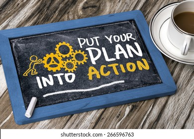 put your plan into action concept handwritten on blackboard