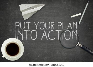 Put your plan into action concept on blackboard with coffee cup