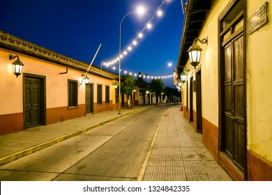 PUTAENDO, CHILE. Beautiful view of the Comercio Street in the downtown of Putaendo city. Colonial style in latin america. Photo of old and historic houses at the night of the chilean town.