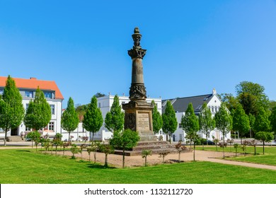 Putbus, Germany - May 09, 2018: Circus square in Putbus on Ruegen. The Putbus Circus is the last uniformly designed circus in Germany, which Prince Wilhelm Malte I of Putbus laid out from 1828