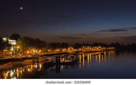 Putney pier and glossy river thames during the dusk