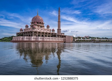 Putra Mosque or pink masjid in Putrajaya during morning time with blue sky, Malaysia.
