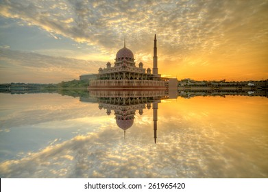 Putra Mosque, Putrajaya, Malaysia during sunrise moments Image has grain or blurry or noise and soft focus when view at full resolution. (Shallow DOF, slight motion blur)