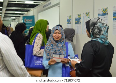 Putra World Trade Centre, Kuala Lumpur, Malaysia. - FEBRUARY 21TH 2017. Teens of all ages attending annual Education Fair to choose a career path and receive vocational counseling.