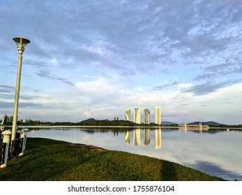 Putrajaya lake with bright sky and government buildings water reflection