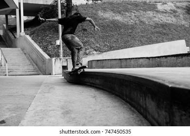 Putrajaya, Malaysia - 1 Nov 2017 : Skateboarder practising a trick at public skatepark in Taman Cabaran, Putrajaya.
