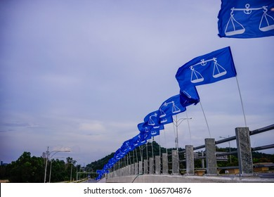 PUTRAJAYA, MALAYSIA - 10 April 2018 : Political flag of the National Coalition party or Barisan Nasional hoisted up high in conjunction of the Malaysian 14th general election in Putrajaya, Malaysia.