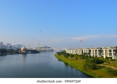 Putrajaya, Malaysia - 12 MARCH 2017 : Scenic morning view of the city with colourful hot air balloons in the skyline during 9th MyBalloonFiesta 2017.
