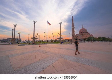 Putrajaya , Malaysia - 13 June 2016 : Amazing view of front space Masjid Putra Putrajaya during sunset hour with colourful colour background in Malaysia before istar in 6 Ramadhan.