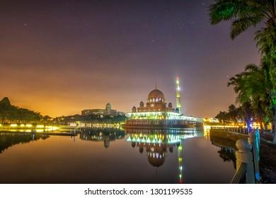 PUTRAJAYA MALAYSIA -14 JANUARY 2019: Night scene of the principal mosque of Putrajaya, The Putra Mosque  is located next to the Perdana Putra.