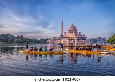PUTRAJAYA MALAYSIA -14 JANUARY 2019: Tourists enjoy dragon boat racing experience at lake near The Putra Mosque in Putrajaya.