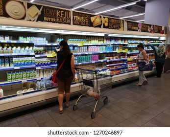 Putrajaya, Malaysia - 25 December 2018 : The girls buys dairy products in the supermarket store. Shopping in a supermarket.