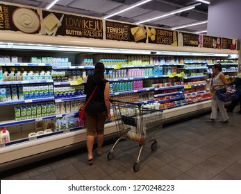 Putrajaya, Malaysia - 25 December 2018 : view a people chooses dairy products in the store. Shopping in a supermarket.