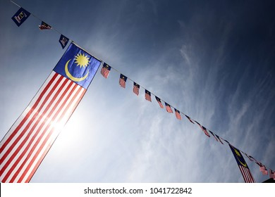Putrajaya, Malaysia, 28th February 2018 - The flag of Malaysia, which was first raised on 16 September 1963, originated from the flag of the Federation of Malaya. shooting with flare tecnique at line