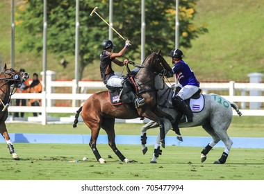 PUTRAJAYA, MALAYSIA 29 AUGUST 2017: Selective focus. Motion blur tones. Polo athlete at the 29th SEA Games at the Equestrian Polo Event at Equestrian Park Putrajaya, Malaysia.