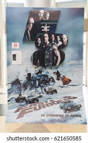 PUTRAJAYA, MALAYSIA - APRIL 8, 2017 : The Fate of the Furious movie poster. This movie is about a mysterious woman who seduces Dom into the world of terrorism and a betrayal of those closest to him.