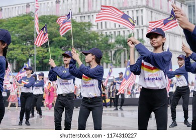 Putrajaya, Malaysia - Aug 31st 2018 : Young teenagers performers dancing proudly during the Malaysia 61st Independence Day / National Day held at the administrative capital of Putrajaya.