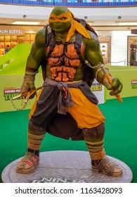 PUTRAJAYA, MALAYSIA - AUGUST 17, 2018: Michealangelo from Teenage Mutant Ninja Turtle (TMNT) replica statue at Putrajaya Mall, Malaysia.