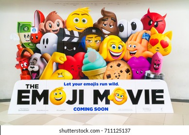 PUTRAJAYA, MALAYSIA - AUGUST 19, 2017: A wall sized Emoji Movie poster displayed at Putrajaya Mall. The Emoji Movie is a 2017 American 3D computer-animated science fiction-comedy.