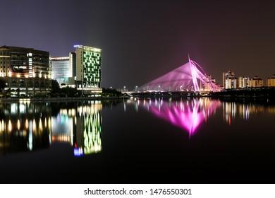 Putrajaya, Malaysia. August 2019, 11 : Night scrap view of Putrajaya near Putrajaya Lake. There are reflection images of Seri Wawasan Bridge and building near by, at lake surface.