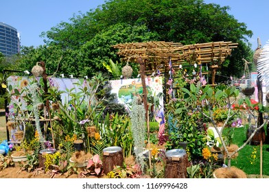 PUTRAJAYA, MALAYSIA -AUGUST 26, 2018: Small pocket garden made from mix of recycle material and flowers at Floria Garden, Putrajaya, Malaysia.