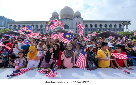 PUTRAJAYA, MALAYSIA - AUGUST 31, 2018 : Malaysian waving Jalur Gemilang flag during National Day celebration parade in Putrajaya. Celebrating the 61th anniversary of independence or Merdeka Day.