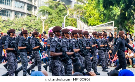 Putrajaya, Malaysia - August 31, 2019: The close up view of the parade contingent marching at the 62nd Independence day or Merdeka  Day celebration of Malaysia in Putrajaya.