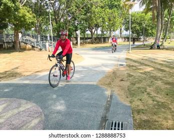 Putrajaya, Malaysia - December 23, 2018; Man cycling road bike in morning. Selective focus.