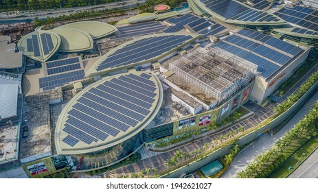 PUTRAJAYA, MALAYSIA - DECEMBER 8, 2020: Solar panel on top of high commercial building. Solar Panel uses photo-voltaic cells use sunlight as a source of energy and generate direct current electricity