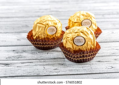"PUTRAJAYA, MALAYSIA - FEB 9, 2017: Ferrero Rocher is a chocolate sweet made by Italian Ferrero Spa. Rocher comes from French and means ""rock"" after a grotto in the Roman Catholic shrine of Lourdes."