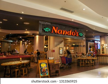 PUTRAJAYA, MALAYSIA - FEBRUARY 14, 2019 : Entrace view of Nando's restaurant in a shopping mall. Nando's is an international casual dining restaurant chain originating in South Africa