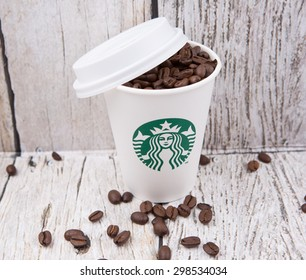 PUTRAJAYA, MALAYSIA - JULY 20TH, 2015. Coffee beans in Starbucks paper cup. Founded in 1971, Starbucks is the largest coffeehouse company in the world.
