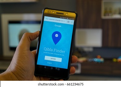 PUTRAJAYA, MALAYSIA - JUNE 14TH, 2017: Modern lifestyle user with smartphone to find direction of Qibla with Google. Qibla in Arabic is direction Muslim prays during salah prayers.