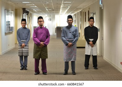 Putrajaya, Malaysia - JUNE 16, 2017: Asian muslim males with traditional Malay costumes, Baju Melayu.