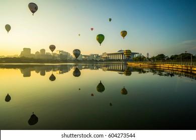 PUTRAJAYA, MALAYSIA - March 12, 2017: Colorful hot air baloons rise and fly across Putrajaya Lake during the Annual Hot Air Balloon Festival in March 12, 2017 at Putrajaya, Malaysia.