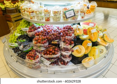 Putrajaya, Malaysia - March 15, 2017: Store shelf display of a lot of fruits grapes, banana, watermelon and others.