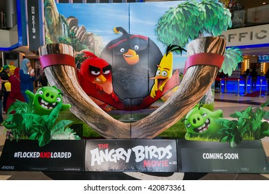PUTRAJAYA, MALAYSIA - MAY 15, 2016: A wall sized Angry Bird poster displayed at IOI Putrajaya Mall. The Angry Birds Movie is a 3D computer-animated action adventure comedy film based on the video game