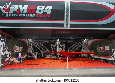 PUTRAJAYA, MALAYSIA - MAY 17, 2014: The Edge 540 V3 plane of Pete McLeod of Canada parks at the hangar before the race during the Red Bull Air Race World Championship 2014 in Putrajaya, Malaysia.