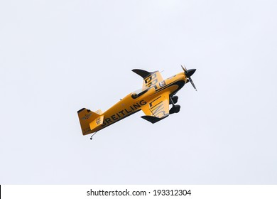 PUTRAJAYA, MALAYSIA - MAY 17, 2014: Nigel Lamb from Great Britain, flying a MXS-R plane takes to the skies at the qualifying session of the Red Bull Air Race World Championship Putrajaya 2014.