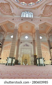 PUTRAJAYA, MALAYSIA - MAY 20, 2015: Inside the Putra Mosque, It is constructed with pink-tinted granite and located in a popular touristic and administrative location.
