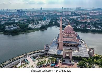 Putrajaya, Malaysia, May 24 2019 - Aerial view of Putra Mosque Putrajaya with Beautiful Lake, It is located next to the Perdana Putra and Putra Square Putrajaya
