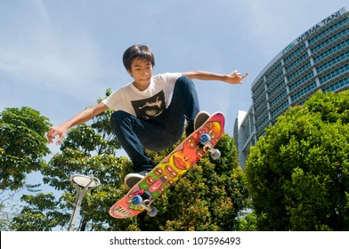 PUTRAJAYA, MALAYSIA - MAY 27: An unidentified skater jumps high in air during  National Youth Day 2012 on May 27, 2012 in Putrajaya Malaysia.