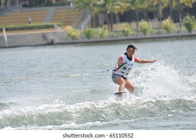 PUTRAJAYA, MALAYSIA - NOVEMBER 14: An unidentified water skier competes in the fourth round of the All Finals Wakeboard Boys and Girls Open Competition during the 2010 Malaysian Waterski & Wakeboard Championship on Nov. 14, 2010 in Putrajaya, Malaysia.