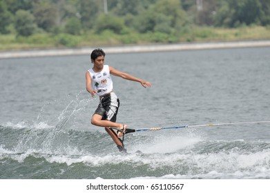 PUTRAJAYA, MALAYSIA - NOVEMBER 14: An unidentified water skier competes in the fourth round of the All Finals Wakeboard Boys & Girls  Open Competition during the 2010 Malaysian Waterski & Wakeboard Championship on Nov. 14, 2010 in Putrajaya, Malaysia.