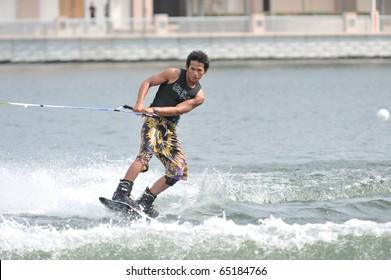 PUTRAJAYA, MALAYSIA - NOVEMBER 14: An unidentified water skier in the All Finals Wakeboard Mens Open during the 2010 Malaysian WaterSki & WakeBoard Championship on Nov. 14, 2010 in Putrajaya, Malaysia